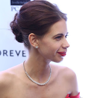 Kalki Koechlin in a Deep neck Red gown at forevermark jewelery event