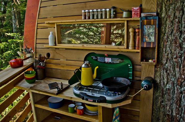 A circular tree house built by Joel Allen in Whistler showing cooking stove