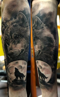 Wolves howling at moon tattoo