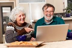 Senior couple using the computer