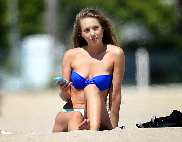 Nora Segura strolled on the beach in Malibu, Santa Monica on Tuesday, July 22, 2014 with a female friend.