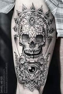 Tattoo de caveira apache no braço