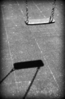 black and white picture of a swing, poem by Rahul