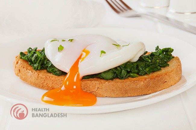Poached eggs on wilted spinach and grainy toast