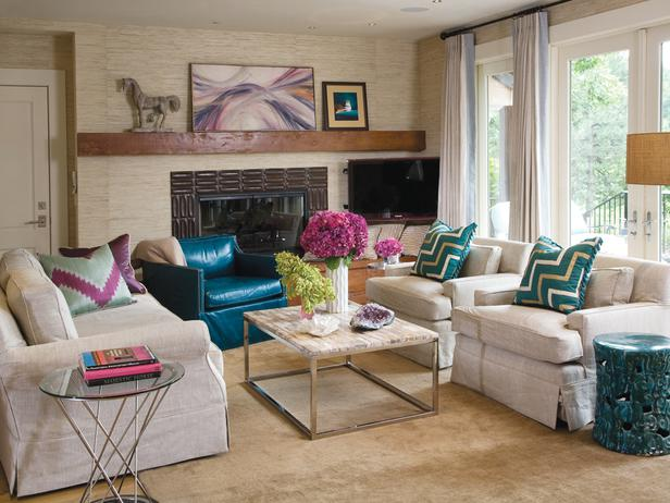 this neutral living room is enlivened by the rich texture of the materials and the bright pops of color tip when using neutral materials select ones that