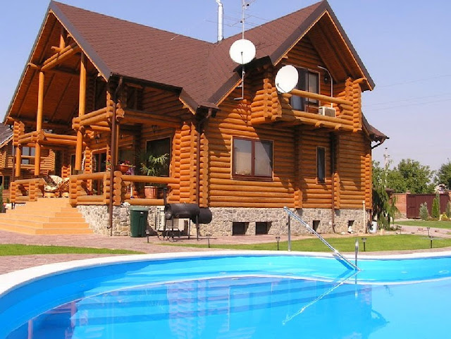 красивый дом бревенчатый дом с уличным бассейном