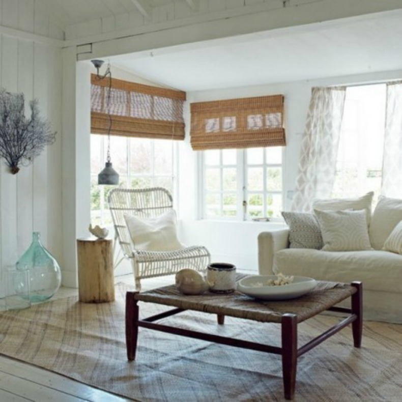 Coastal cottage living room with white and weathered rattan furnishings