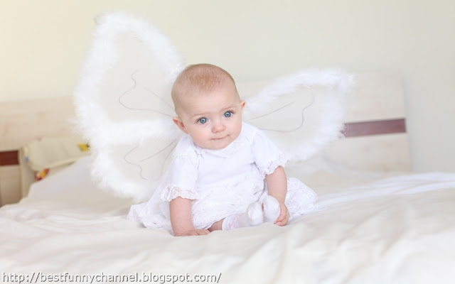 Funny baby angel.