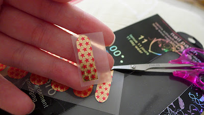 First cut out the little nail finger nail patch size from the attached nail patch.