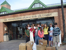 Lab School of Washington Students Stand with their Collection for the Animals!