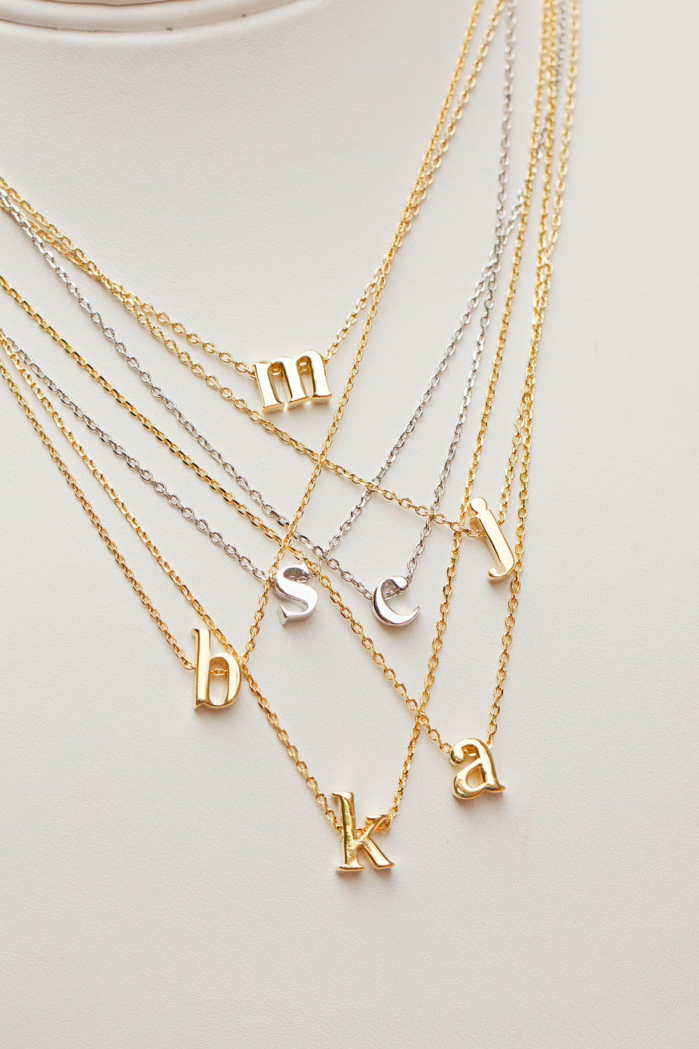This Small Initial Necklace is sure to capture your heart, with its delicate and one-of-a-kind personalized design. Effortlessly made from your choice of sterling silver, gold, or rose gold, this mini initial pendant necklace is just what you've been looking for.