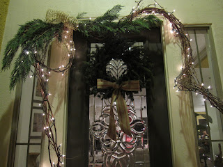 front door Christmas wreath with lighted grapevine