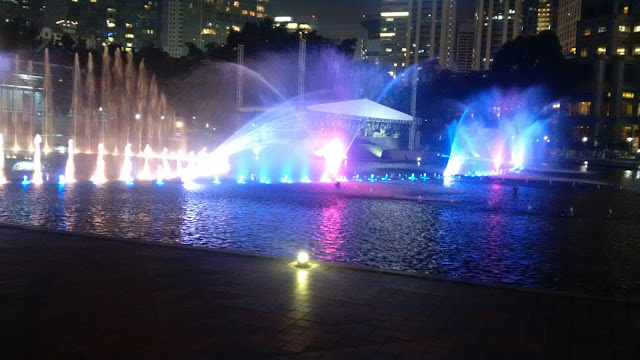 KLCC Park, Suria KLCC, children's playground, symphony fountain, wading pool, jogging track, shelters, benches, patterned foot-paths, sculptures, Lake Symphony, travel,