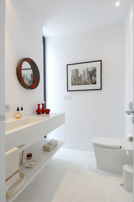 Small white bathroom in Sotogrande House by A-Cero Architects