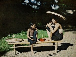 Eating betel for red lips & black teeth (1921)