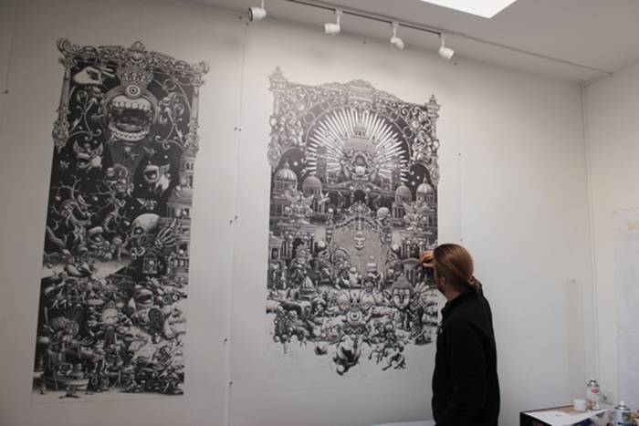 Joe Fenton continues to mesmerize us with his skilled hand and imaginative mind at work on the latest addition to his ongoing series titled The Landing. The artist has just recently completed the second and biggest panel of his large-scale triptych. The first two of his three-part drawings feature his signature monochromatic style in graphite on paper.