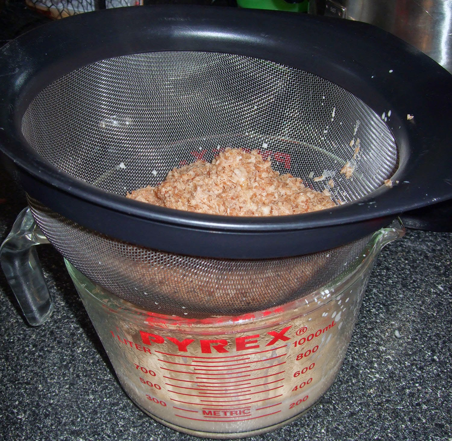 Straining out toasted coconut.