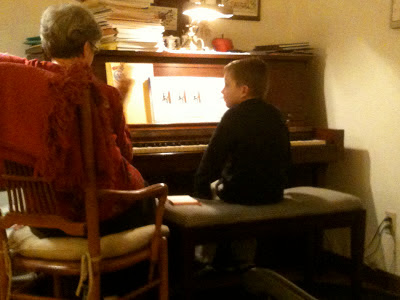 Logan's first piano lesson.