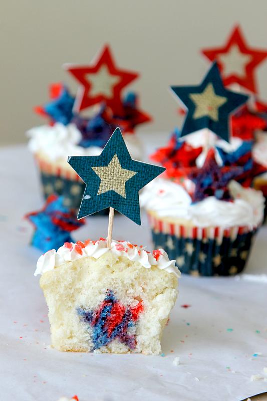 http://www.momdot.com/firecracker-surprise-inside-cupcakes/