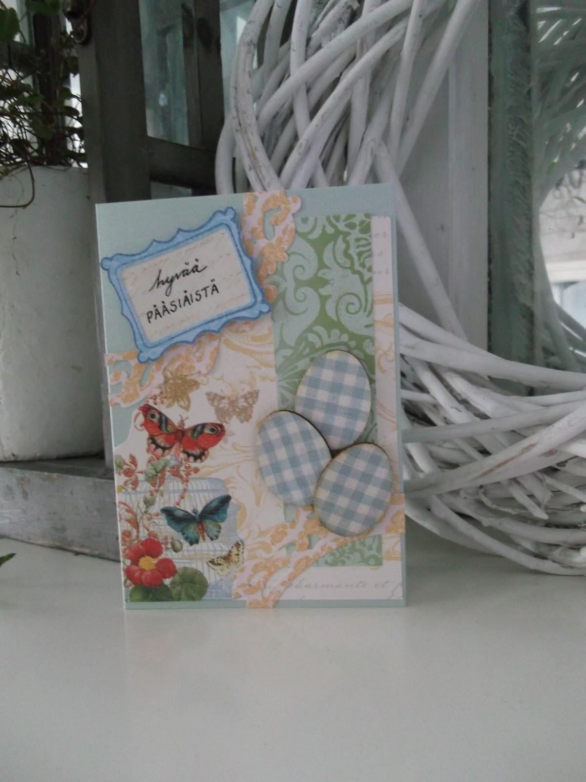 itsetehty pääsiäiskortti, jossa perhosia ja pääsiäismunia