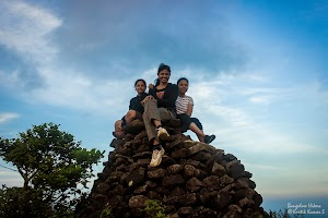 Girls sat on the top most rock at Kumara Parvatha peak