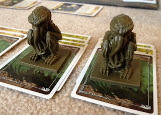 Cthulhu figures from card game