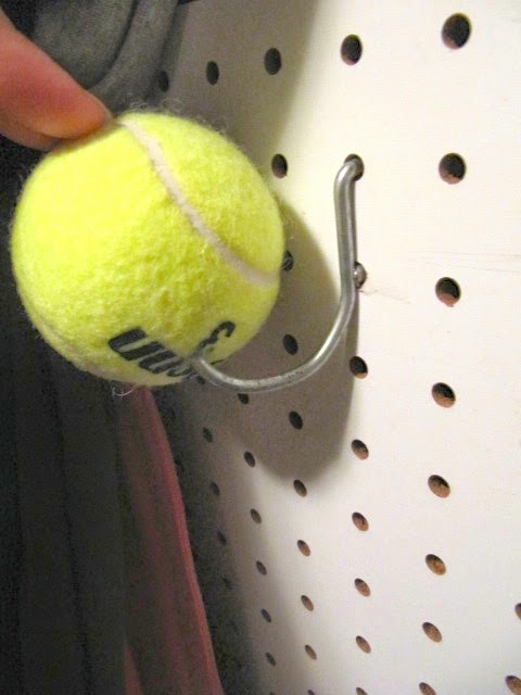 closet organizing peg board wall