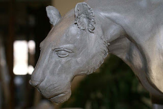 building a clay sculpture, clay panther sculpture, creating a ceramic lion sculpture
