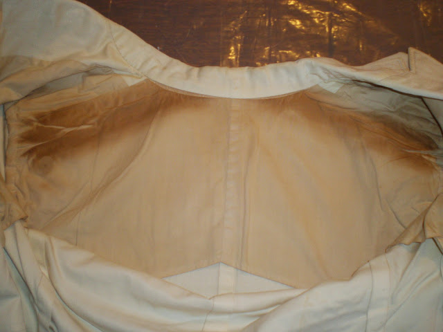 textile conservation, proper storage, archival materials, damage to artifacts, improper handling or storage