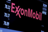 The logo of Exxon Mobil Corporation is shown on a monitor above the floor of the New York Stock Exchange in New York, December 30, 2015. (Credit: Reuters/Lucas Jackson) Click to enlarge.