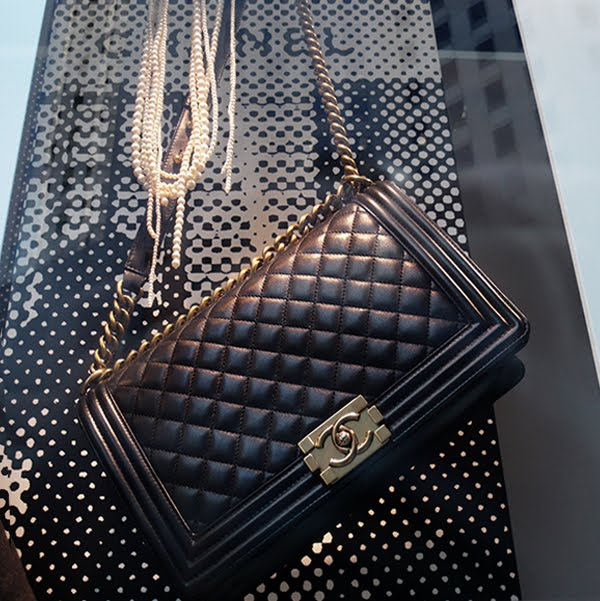 Chanel Le Boy bag and Coco's fav pearls.