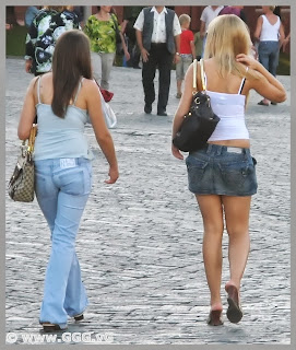 Girl in jean skirt on the street