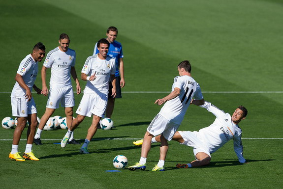 Real Madrid's new signing Gareth Bale is tackled by Cristiano Ronaldo during a training session
