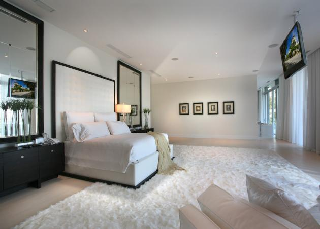 White bedroom in the Modern Villa by Touzet Studio