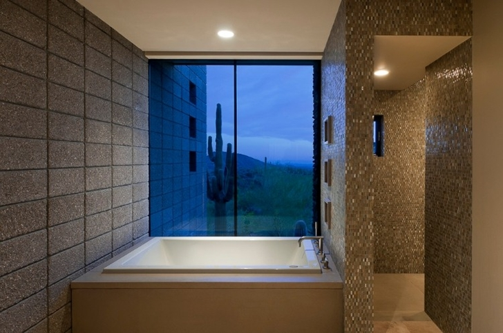 Bathtub in Modern desert home by Tate Studio
