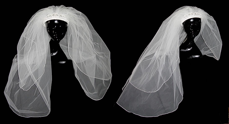 This lovely white vintage veil has a crown style headpiece