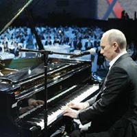 Mr. Putin performs on grand piano