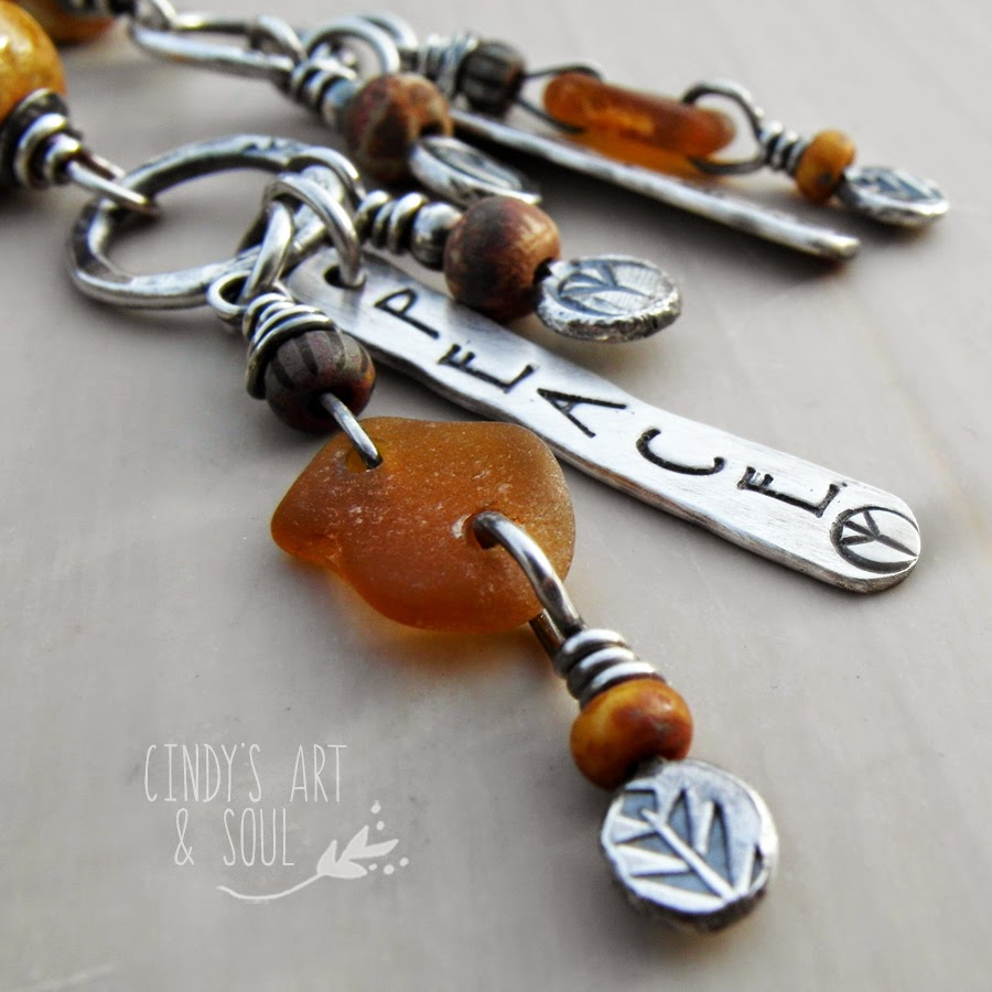 http://www.artandsouljewelry.com/collections/earrings/products/peace-earrings-ceramic-and-silver-handmade-jewelry