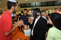 Israelis collect gas masks