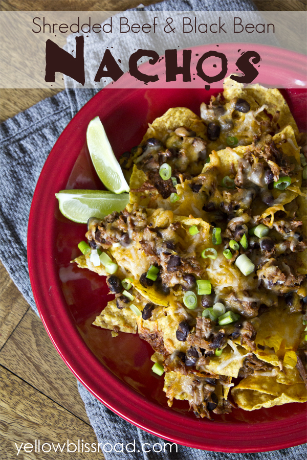 Shredded beef and black bean nachos! Create an easy Mexican meal or snack with just a minutes and a few ingredients. The perfect snack for Cinco de Mayo!!