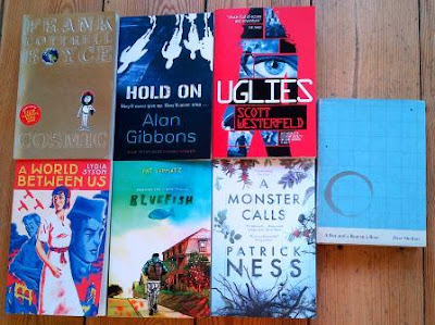 Covers for Cosmic by Frank Cottrell Boyce, A World Between Us by Lydia Syson, Bluefish by Pat Schmatz, A Monster Calls by Patrick Ness, Hold On by Alan Gibbons and Uglies by Scott Westerfeld