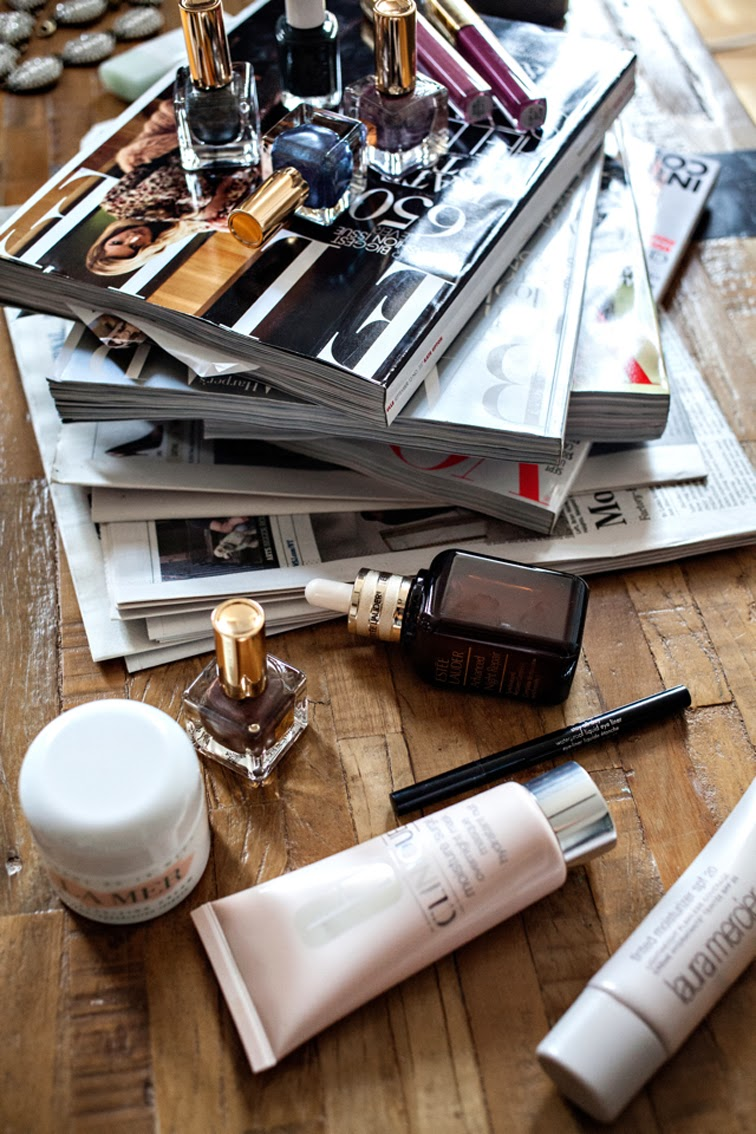 Beauty essentials magazine pile