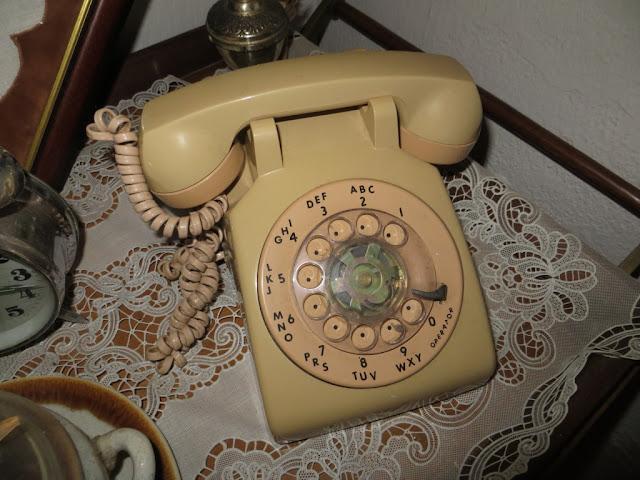 Fotografia macro de Telefone Antigo com Disco de cor bege