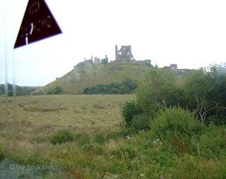 Books-in-the-Wild-on-an-adventure.-Corfe-Castle-seen-from-the-window-of-a-steam-train.