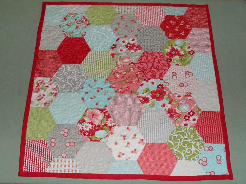 possum blossom patchwork quilt made from a hexagon