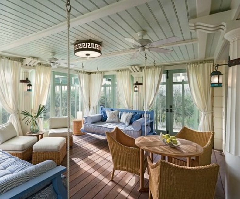 Beautiful walls of windows and hues of soft blues make this outdoor space our favorite spot in the house.