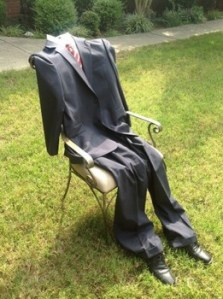 EMpty suit and chair