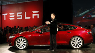 <img src='exampleurlimage' alt= 'Tesla Sets March 2016 Unveiling Of Less Pricey Model 3 ' title= 'Tesla Sets March 2016 Unveiling Of Less Pricey Model 3 ' />