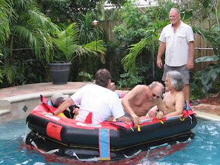 John Kretschmer supervises a life raft launch in a swimming pool