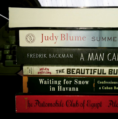 Zeroes, by Chuck Wendig (the bound manuscript with no spine) Summer Sister, by Judy Blume A Man Called Ove, by Frederik Backman The Beautiful Bureaucrat, by Helen Phillips Waiting for Snow in Havana, by Carlos Eire The Automobile Club of Egypt, by Alaa Al Aswany